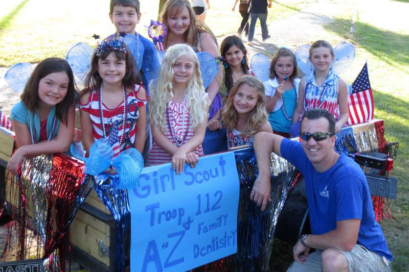 Dr. Massie with Girl Scouts at Parade